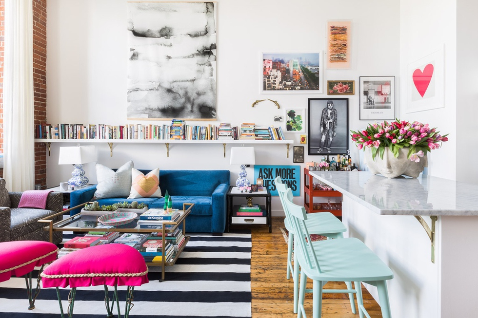 blue sofa in eclectic living room