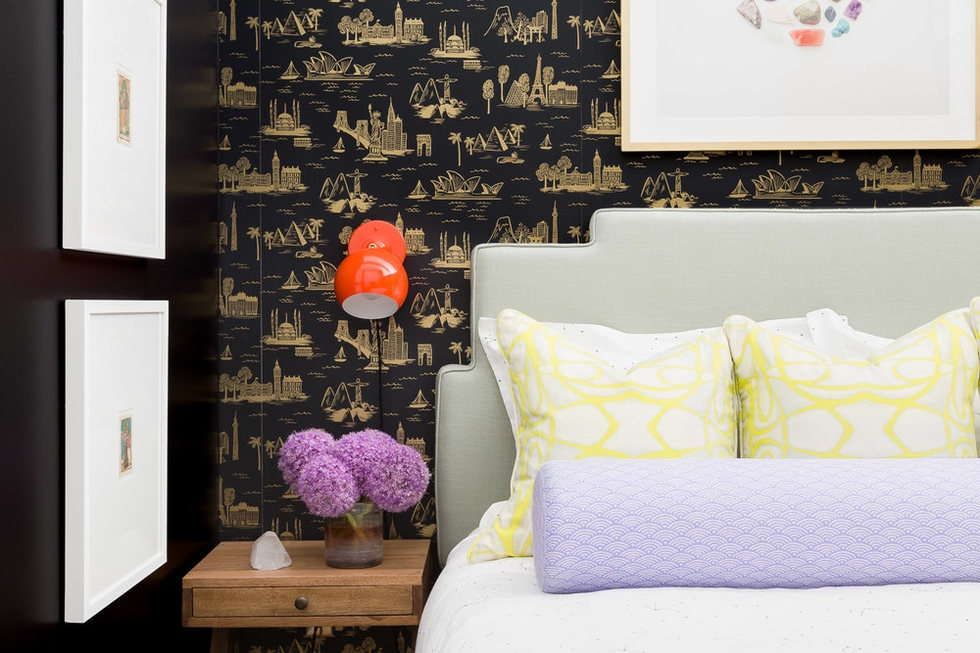 Bedroom With Dark Wallpaper and Bright Pillows