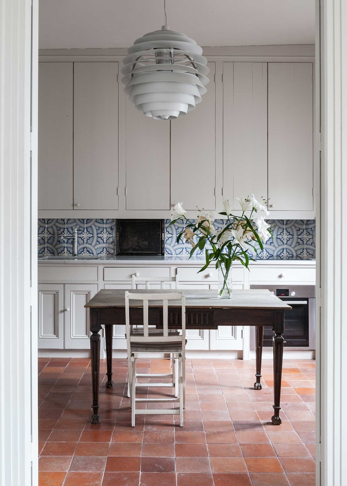 Kitchen With Terracotta Tile and Artichoke Lamp