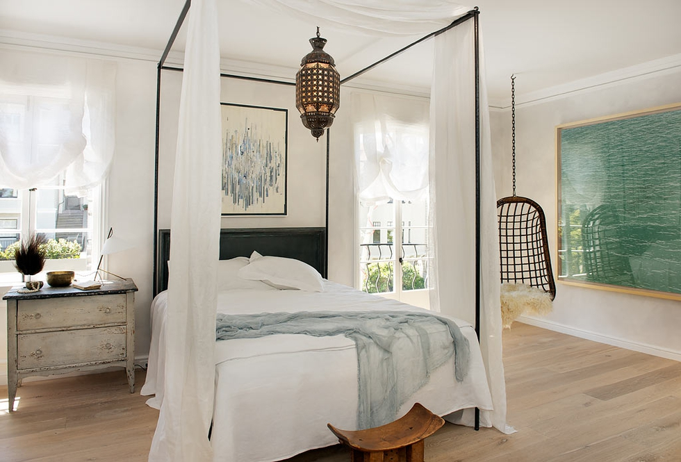 Elegant White Bedroom With Coastal Photography Designed by Will Wick